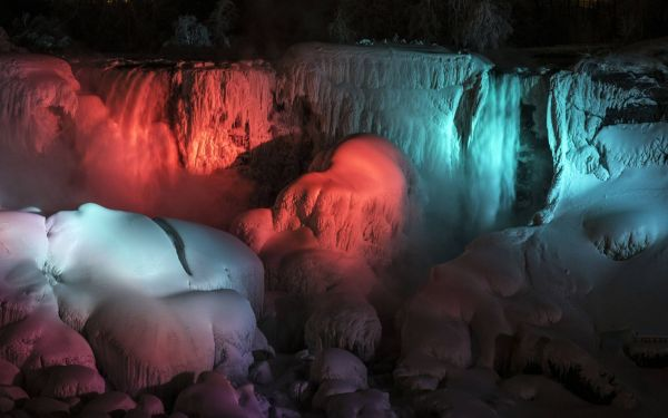 Frozen Niagara Falls bathed in colors