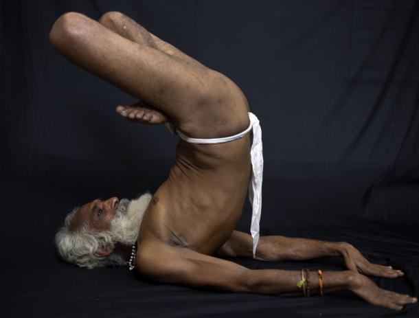 ndia's holy men practising yoga 14
