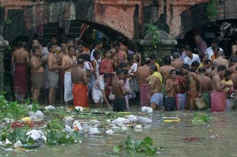 people bathing in ganges