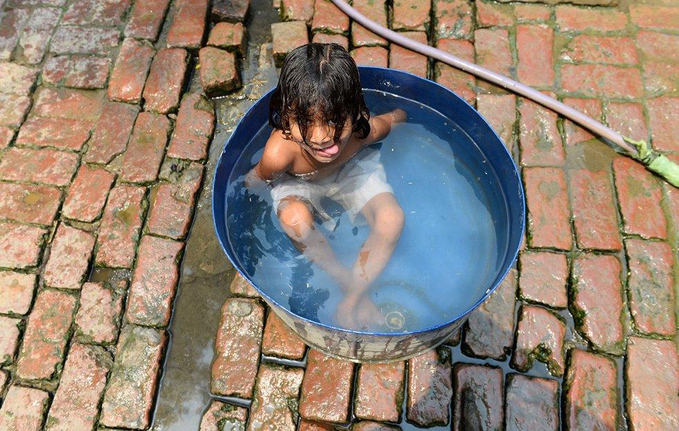Bathing in contaminated water in Gangnauli village in Uttar Pradesh
