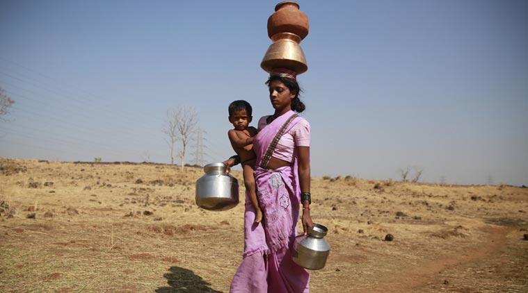 While on her way to a communal tube well at Raichi Wadi village, Mumba