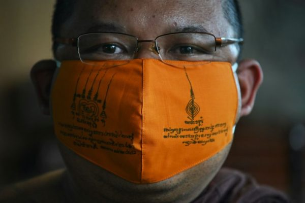 Amidst Coronavirus Buddhist Monks in Thailand Recycle Plastic to Make Face Masks